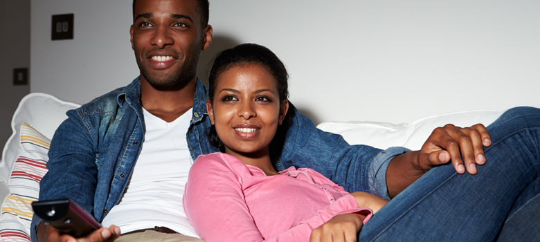 black family watching tv. black couple watching television family tv