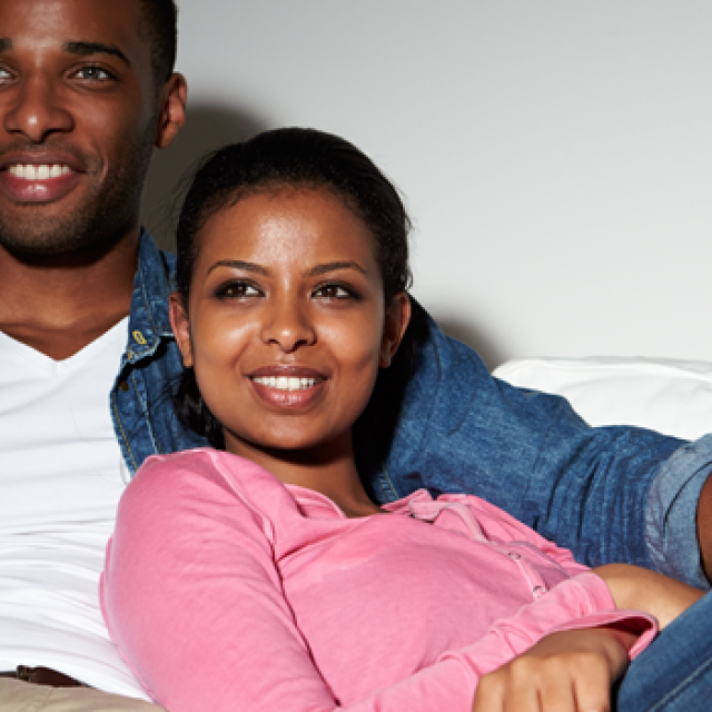 Black Couple Watching Television